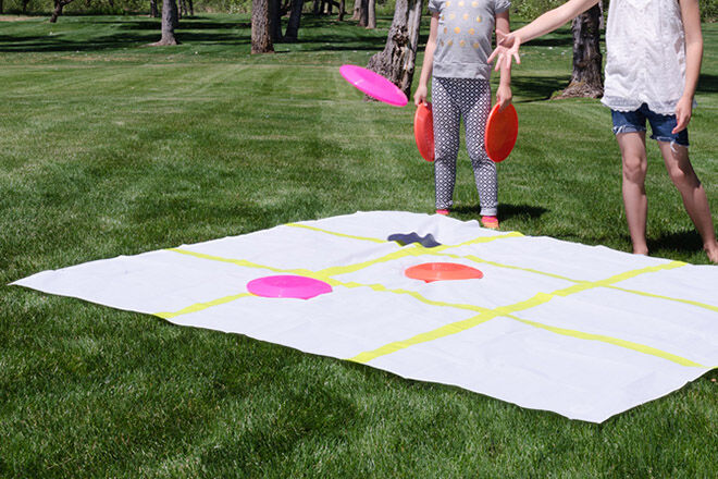 Use a shower curtain and frisbees to play outdoor tic tac toe.