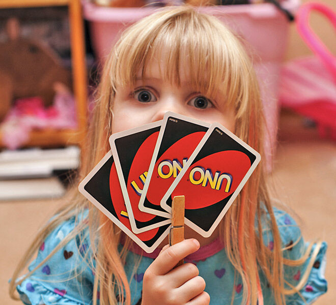 Parenting hack to help toddlers hold playing cards - use a clothes peg | Mum's Grapevine