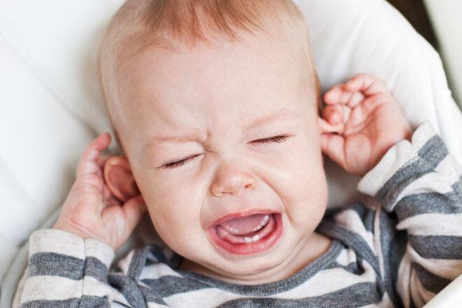 Baby teething pulling ears
