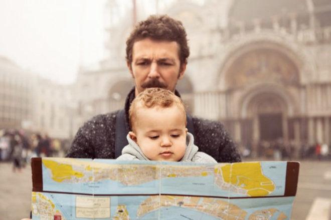 Italian man holding a baby