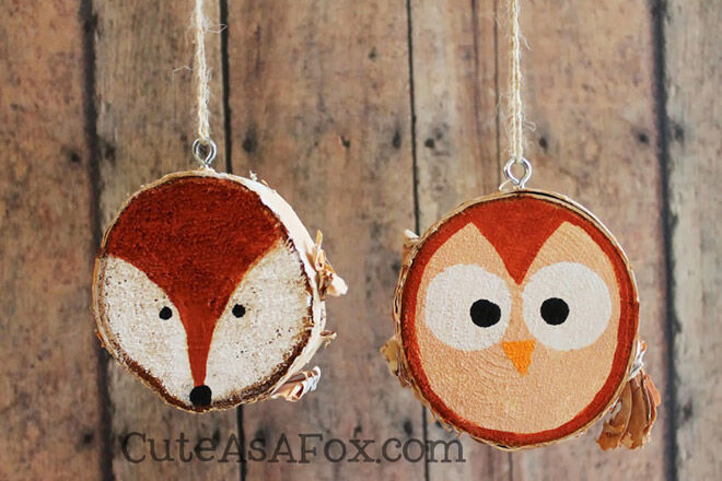 Wooden branch slices painted with fox and owl, decorations for Christmas tree