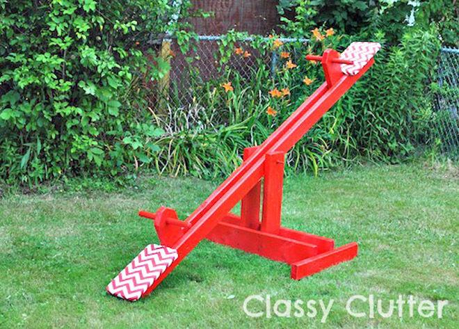 make a backyard seesaw