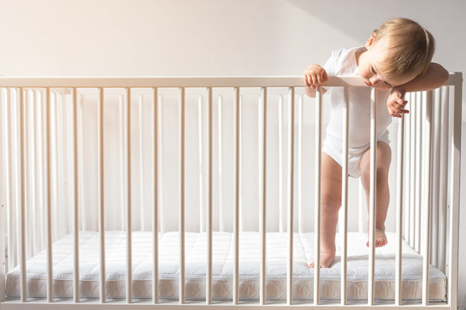 when to move child from cot to bed