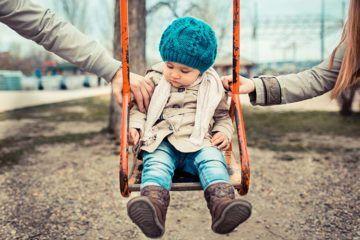 child sitting on a swing
