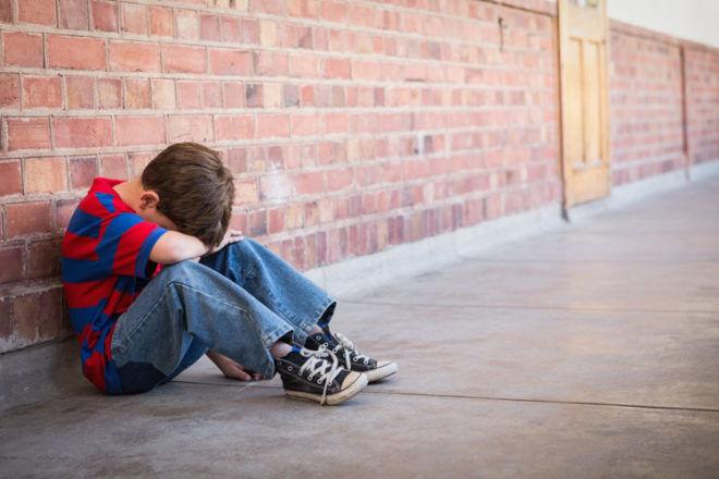 boy crying in the school yard