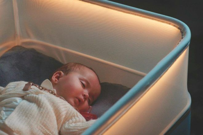 baby asleep in Max Motor Dreams cot bassinet from Ford Motor Company