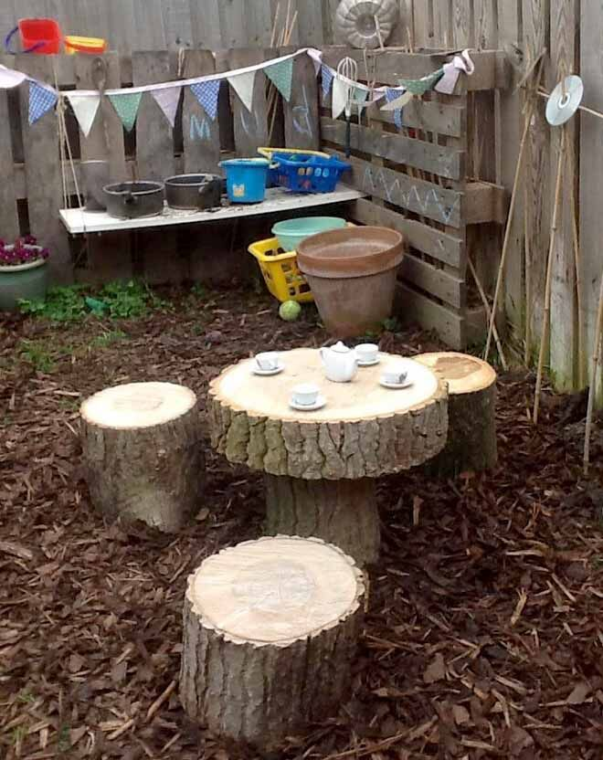 tree trunk table and chairs set in mud kitchen