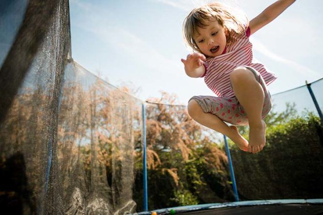 happy child playing on trampoline