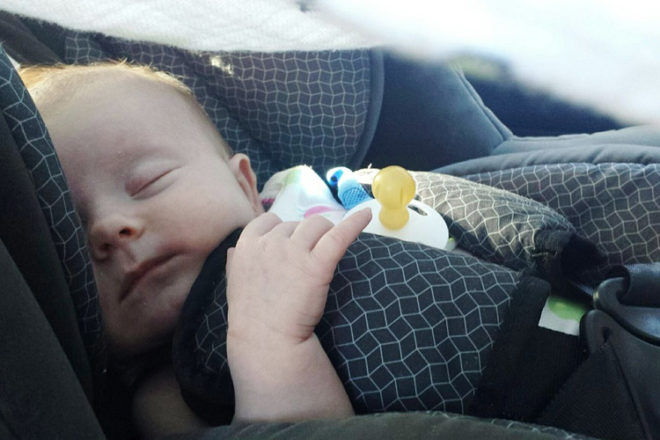 newborn asleep in car
