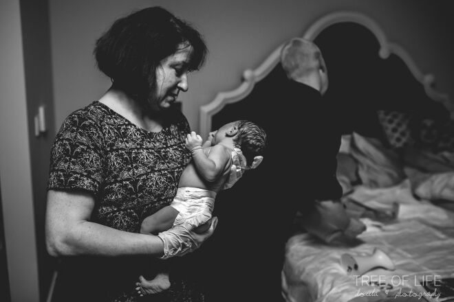 midwife delivers baby Tree of Life Doula Photography