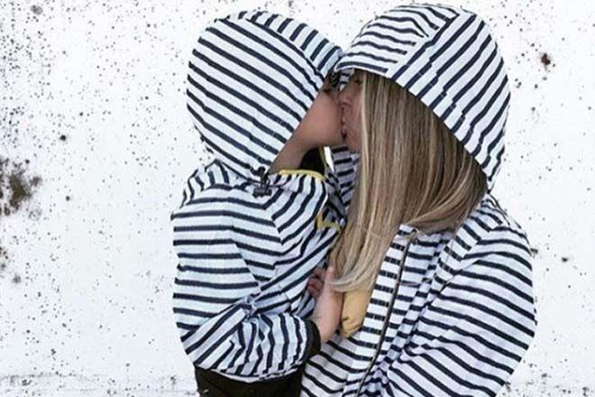 matching raincoats mum and child