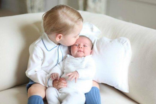 Prince George kisses baby Princess Charlotte