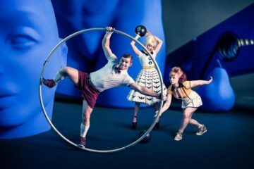 Circus Oz actors with assortment of ball props