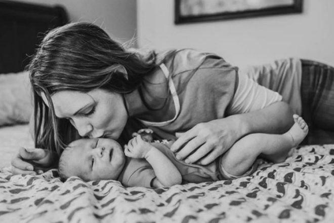 Mother and newborn on bed Alyssa Duncan Photography