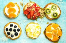 pancakes topped with fruit and yoghurt