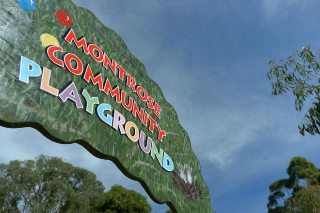 Montrose Community Playground sign with sky in the background