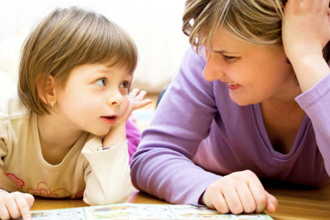 Mum talking to her child