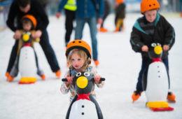 river rink ice skating little girl penguin