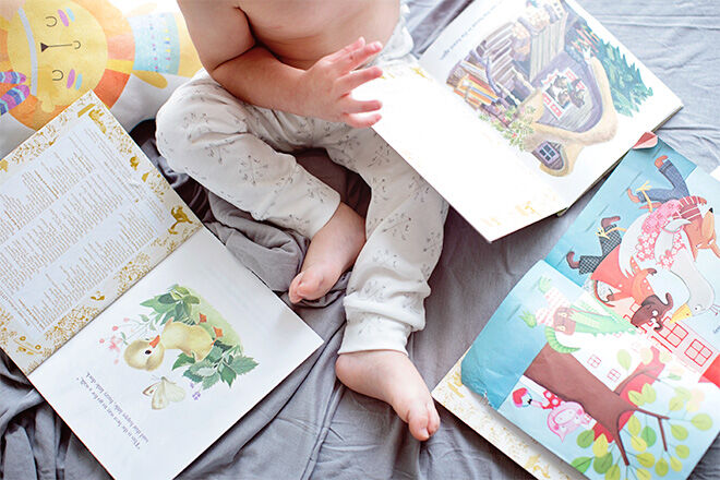 Keep your toddler entertained with books while feeding your newborn