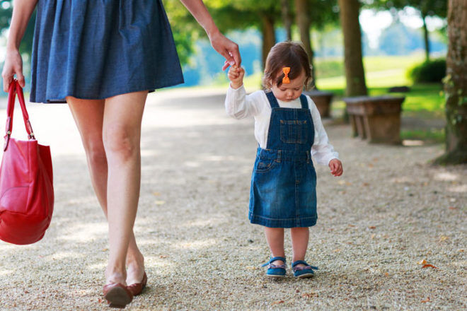 mum walking outdoors with toddler