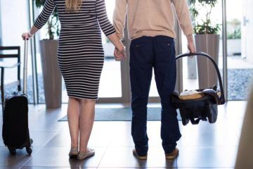 couple leaving hospital with newborn baby