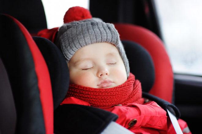 Toddler sleeping in car