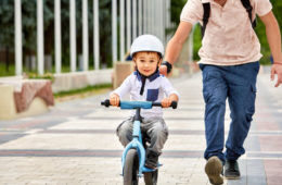 Toddler learning to ride a bike
