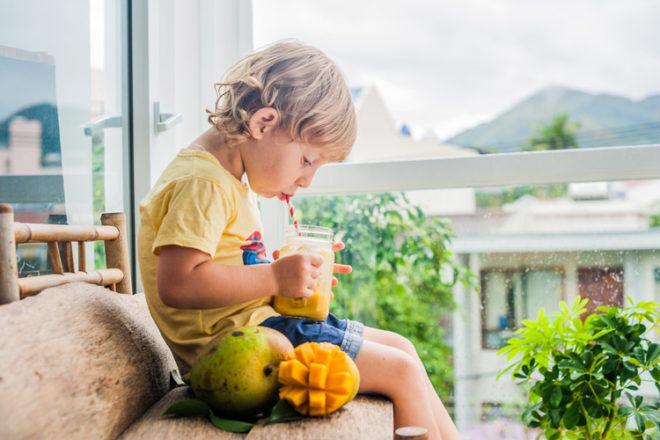 Boy drinking mango smoothie