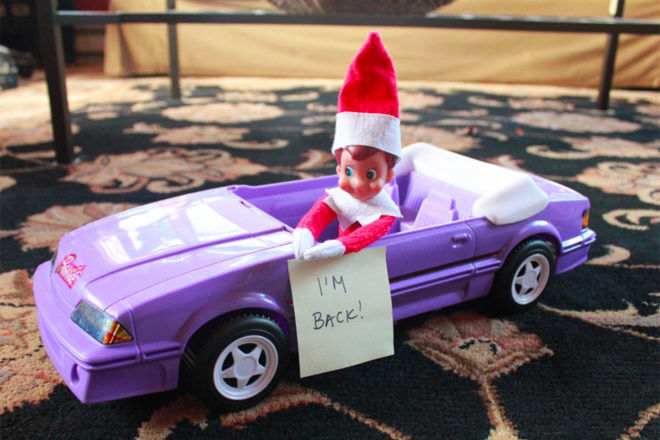 elf on the shelf arrival in a purple convertable