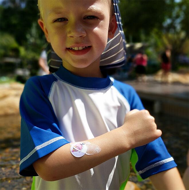 child wearing a Suncayr sunscreen spot
