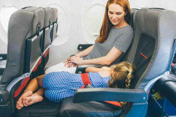 Plane Pals toddler sleeping on plave
