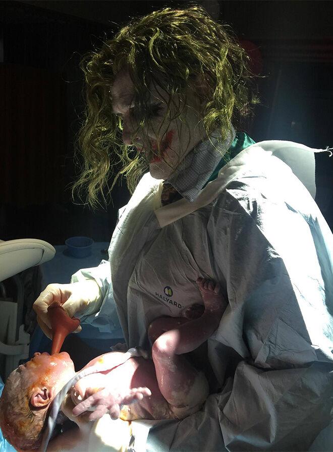 Dr Joker delivering baby born on Halloween