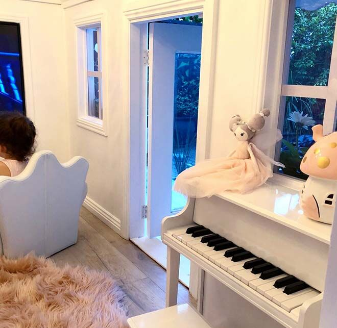 Baby grand piano in cubby house