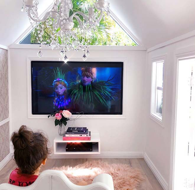 Cubby house with television