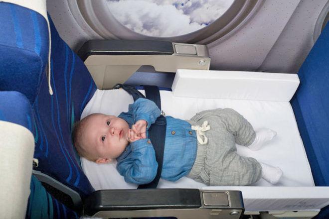 JetKids bedbox baby asleep on plane