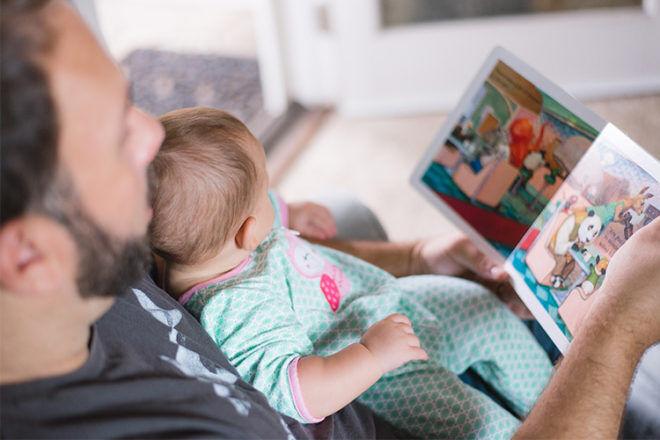 Dad reading to toddler
