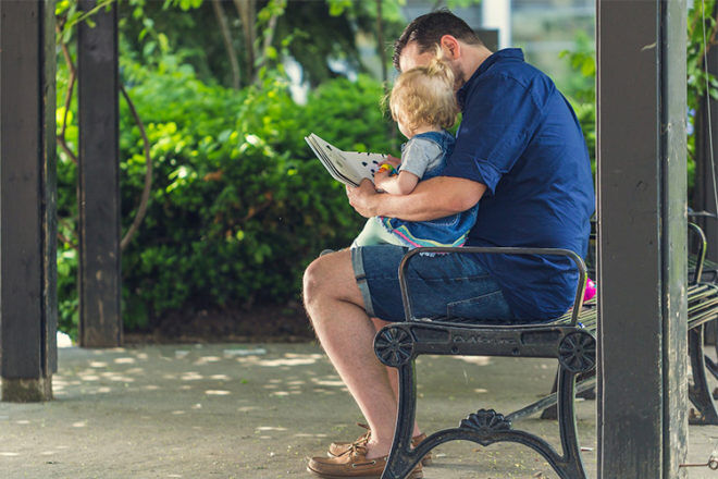 Toddler reading with dad