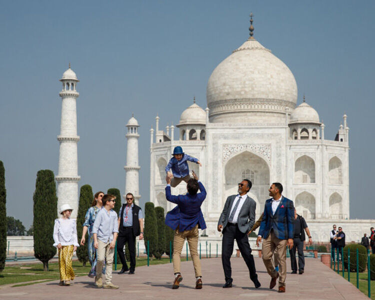 Hadrien Trudeau being thrown into the air on trip to India