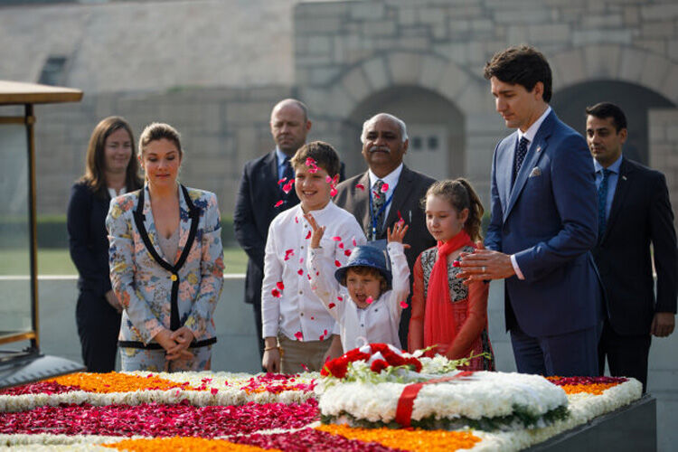 Hadrien Trudeau throwing petals on trip to India