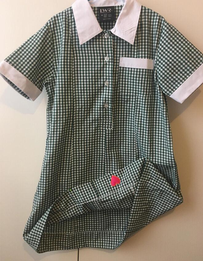 Heart hug button in uniform