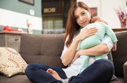 women holding sleeping baby