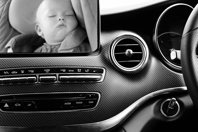 baby asleep in car on camera