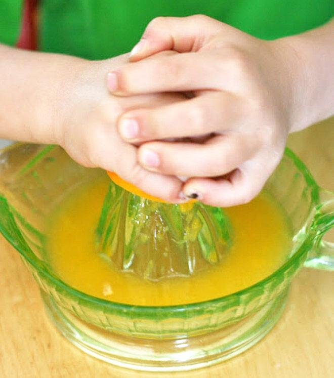 Kids squeeze orange juice