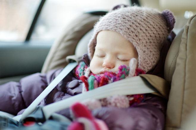 Baby asleep in car seat winter