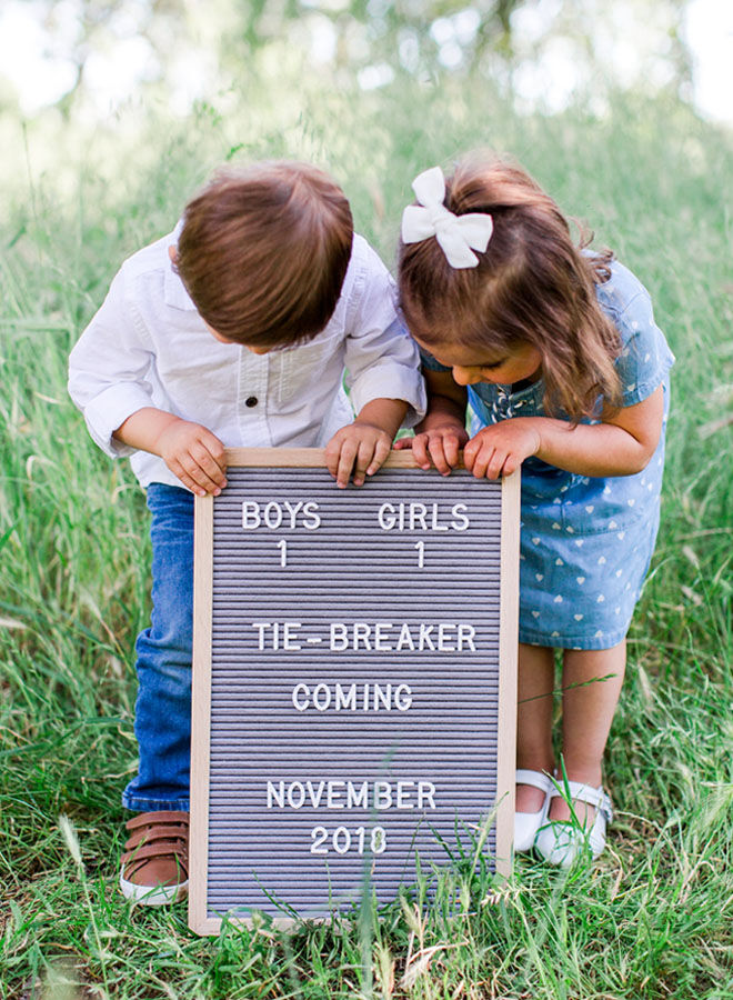 Brother and sister pregnancy announcement with letter board