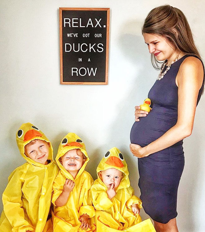 Ducks in a row pregnancy announcement with three siblings