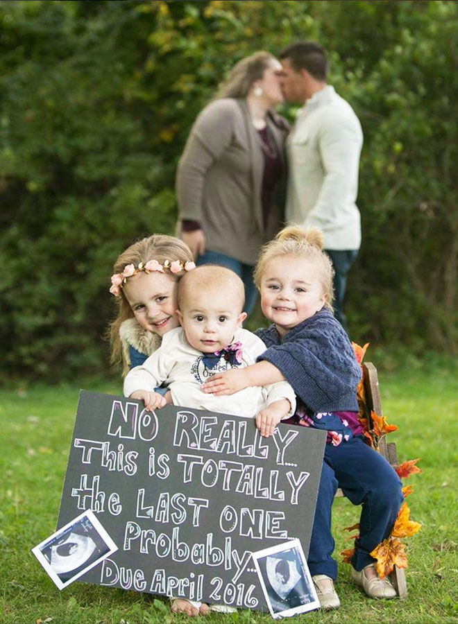 Sibling pregnancy announcement with chalkboard