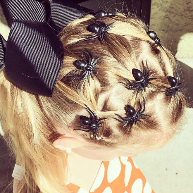 Halloween hairstyle with spiders and a bow