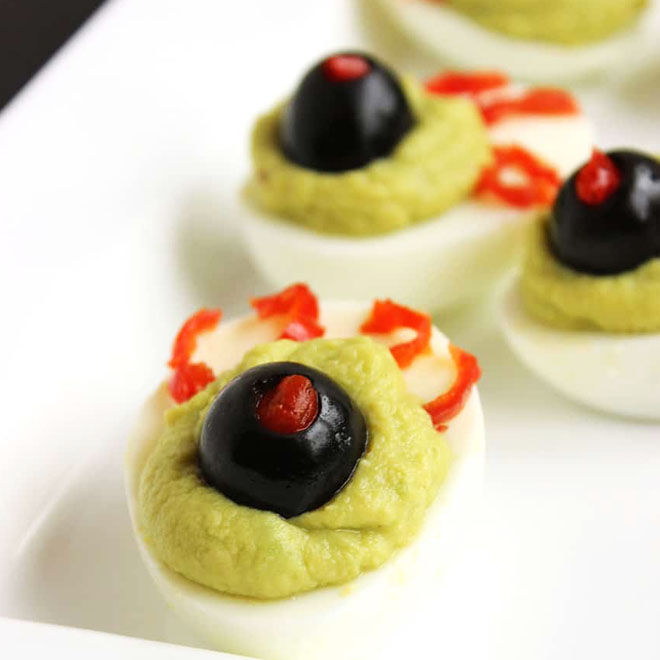 Scary devilled eggs with olives and avocado