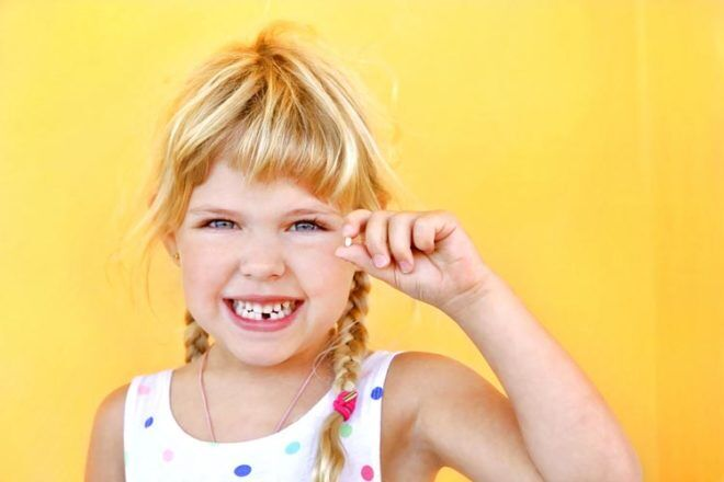 Girl Missing Tooth traditions around the world